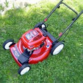 Lawnmower parked on a lush yard.