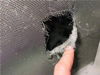 A hole in a screen.